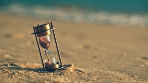 Hourglass On Sand Beach